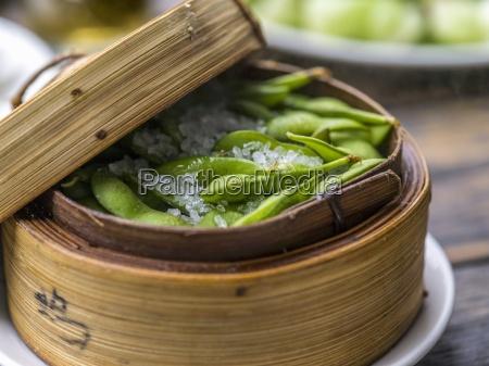 soya beans in a bamboo steamer