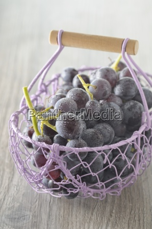 freshly washed red grapes in a