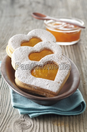 heartshaped biscuits with apricot jam