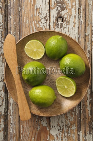 limes whole and halved in a