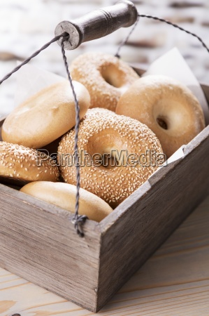bagels in a wooden crate with