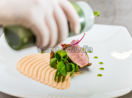 chef finishing her plate