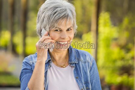 mature woman talking at phone