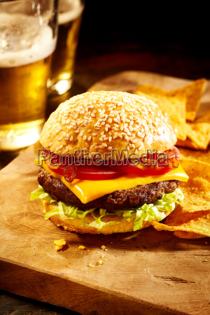 cheeseburger with chips and beer in