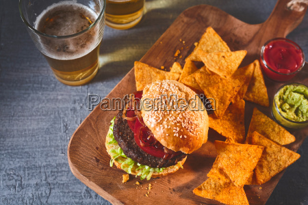 cropped view of burger chips and