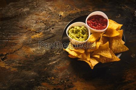 nachos guacamole and salsa dip with