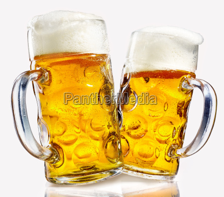 two glass beer mugs full of