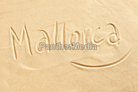 mallorca handwritten in golden beach sand