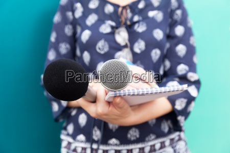 female journalist or reporter at press