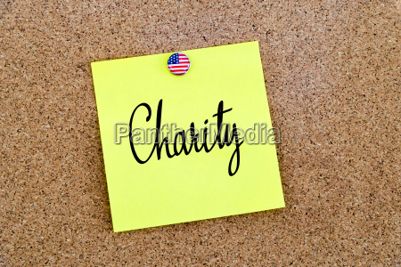 written text charity over yellow paper