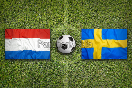 netherlands vs sweden flags on soccer
