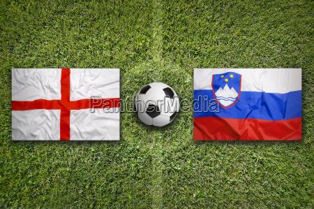 england vs slovenia flags on soccer