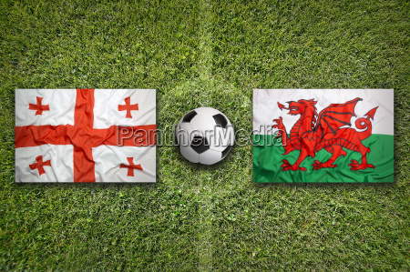 georgia vs wales flags on soccer