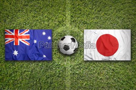 australia vs japan flags on soccer