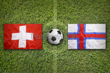 switzerland vs faeroe islands flags on