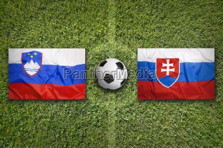 slovenia vs slovakia flags on soccer