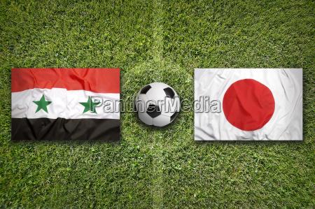 iraq vs japan flags on soccer