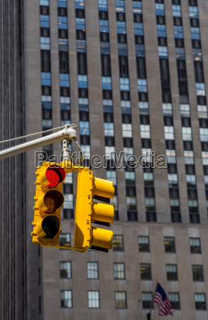 yellow traffic light on the background
