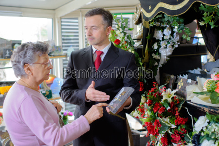 funeral director showing woman a memorial