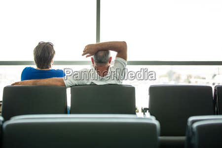 senior couple waiting for their flight