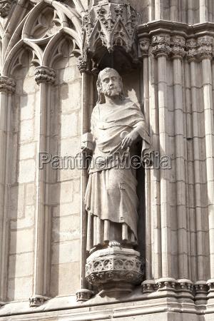 statue on facade of church