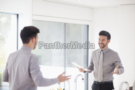 mid adult businessman practicing presentation in