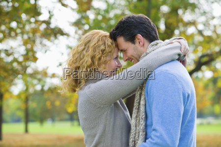 mid adult couple embracing in autumn