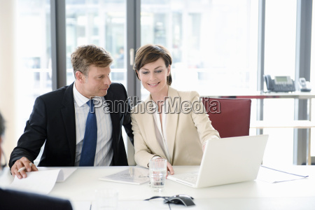 business colleagues looking at laptop