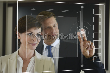 business colleagues looking at screen