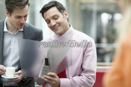 business colleagues holding files in meeting