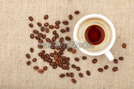 empty espresso cup and coffee beans