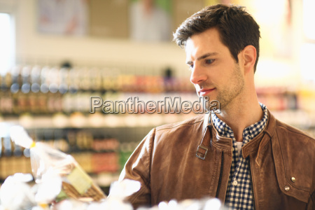 mid adult man shopping in an