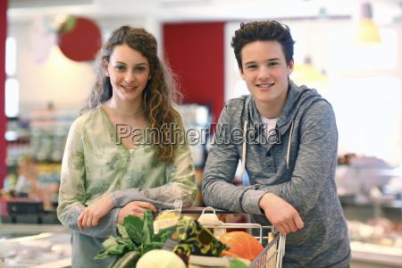 teenager couple shopping in an organic