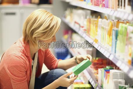 woman shopping for cosmetics in organic