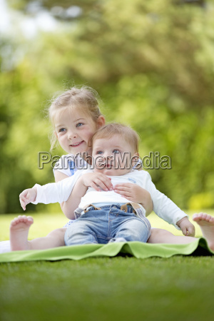 brother and sister together in park
