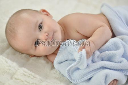 baby boy holding blanket portrait