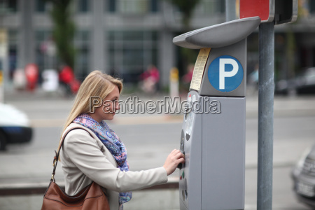 mid adult woman paying at parking