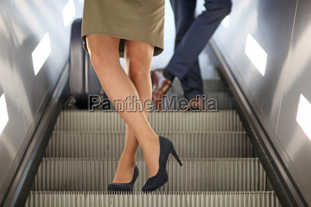businesswoman in high heels travelling on