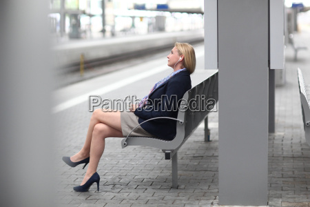 mid adult businesswoman on station platform