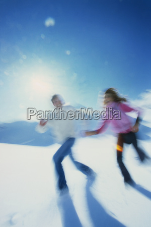 blurred motion of young couple running
