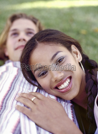 portrait of a young couple laying
