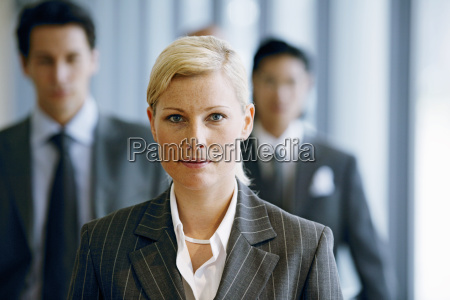 view of a businesswoman with businessmen