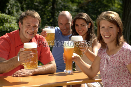 portrait of two couples drinking beer