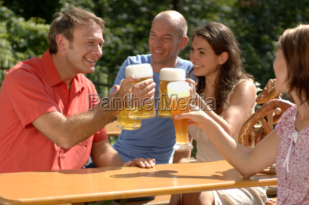 portrait of two couples toasting each