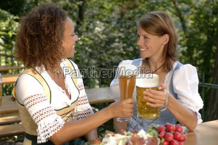 view of two young women toasting