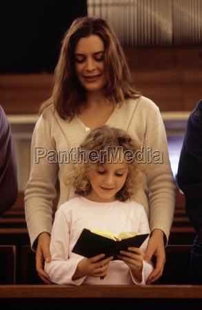 woman and child reading a bible