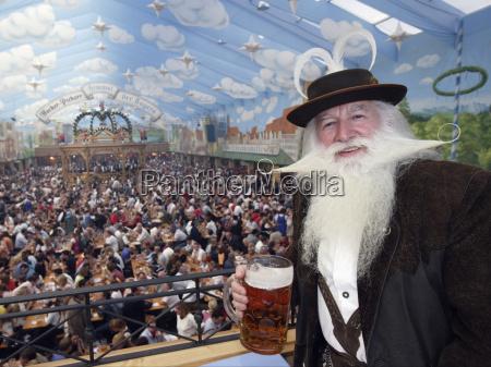 large crowd enjoying food and drinks
