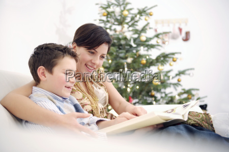 mother and young son reading on