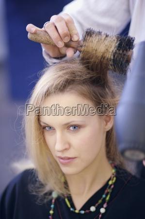 close up of woman having hair