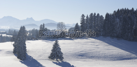 farm in snowy landscape upper bavaria